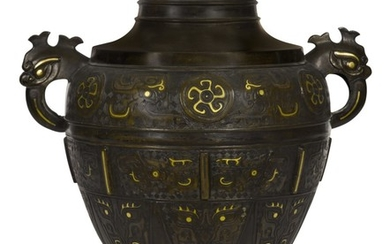 A LARGE GOLD AND SILVER-INLAID BRONZE ARCHAISTIC VASE QING DYNASTY, 17TH/18TH CENTURY | 清十七/十八世紀 銅錯金銀仿古夔鳳紋雙耳大瓶