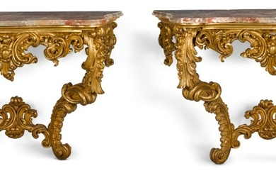 A PAIR OF ROCOCO STYLE CARVED GILTWOOD CONSOLE TABLES, PROBABLY FRENCH LATE 19TH CENTURY
