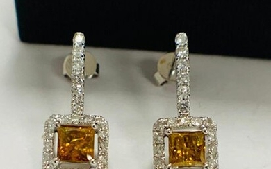 14ct White Gold Yellow Diamond earrings featuring, 2...