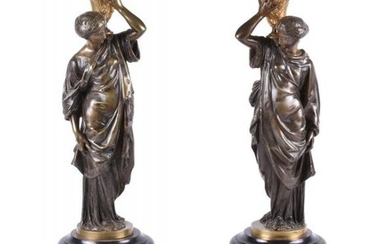 A pair of French gilt bronze and Noir Belge mounted figural candle holders in Orientalist taste, circa 1870