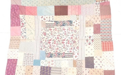 A 19th Century Printed Cotton Patchwork Bed Cover, with central...