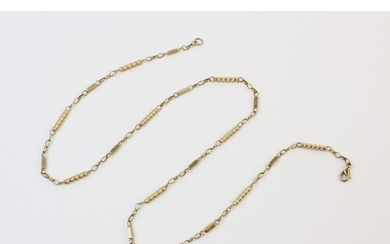 A 9ct yellow gold fancy link chain, comprising alternating s...