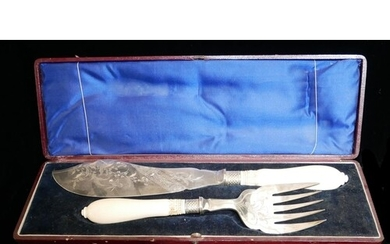 A CASED PAIR OF VICTORIAN SILVER PLATE AND IVORY FISH SERVER...