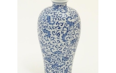 A Chinese blue and white 'Plum' vase decorated with scrollin...