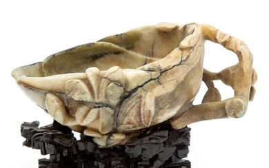 A Chinese carved jade brush washer on wooden base