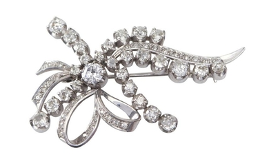 A DIAMOND BROOCH - Of bow design, set with old European cut diamonds totalling 4.10cts, in 18ct white gold.