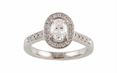 A DIAMOND CLUSTER RING, of oval form, mounted in platinum. E...