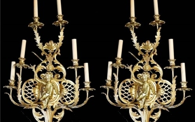A LARGE PAIR OF EARLY 20TH CENTURY POLISHED BRASS SIX BRANCH...