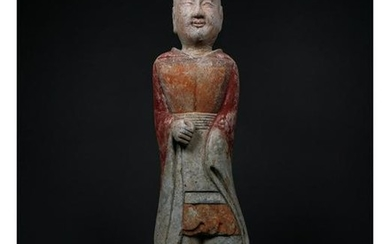 A PAINTED GREY POTTERY FIGURE OF AN ATTENDANT