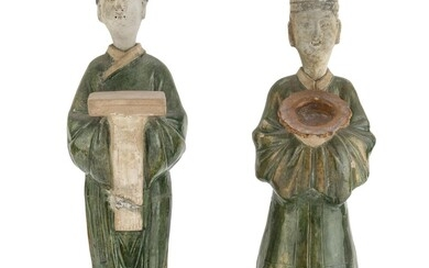 A PAIR OF CHINESE GLAZED CERAMIC SCULPTURES REPRESENTING ORDERLIES 16TH-17TH CENTURY.
