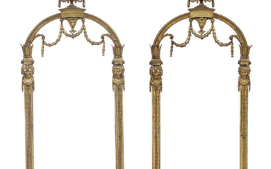 A PAIR OF GEORGE III LACQUERED-BRASS PANELS, DELIVERED BY THOMAS CHIPPENDALE, 1774, ORIGINALLY PART OF THE HEXAGONAL HALL LANTERN AT HAREWOOD HOUSE