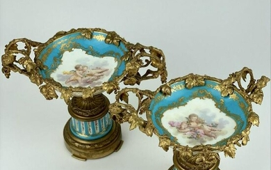 A PAIR OF DORE BRONZE MOUNTED SEVRES TAZZAS