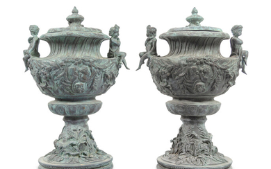 A Pair of Louis XV Style Cast Iron Covered Garden Urns