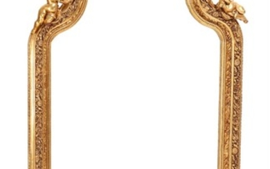 A Rococo style mirror in a gilded wood and gesso frame, richly carved with rocailles, putti and flowers. 20th-21st century. H. 220. W. 116 cm.