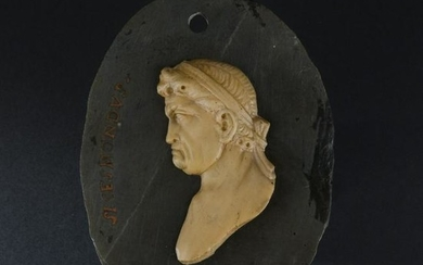 A Roman black marble and giallo di Siena oval medallion