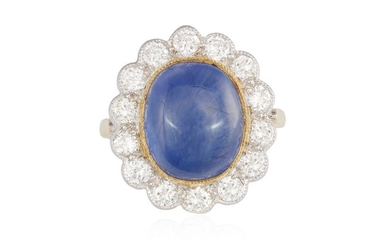 A SAPPHIRE AND DIAMOND CLUSTER RING, The oval-shaped...