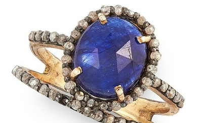 A SAPPHIRE AND DIAMOND RING set with a faceted topped