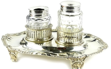 A Victorian silver inkstand, of oval form with gadrooned...