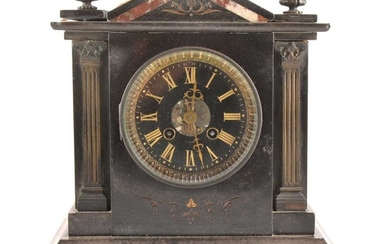 A Victorian slate and marble mantel clock