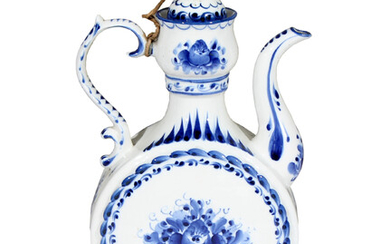 A blue and white ceramic teapot decorated with florals