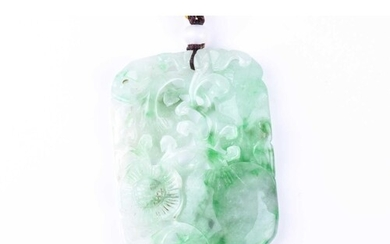 A carved jade pendant, the rounded rectangular panel carved ...