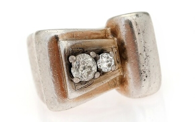 NOT SOLD. A diamond ring set with two old-cut diamonds, mounted in silver. Size app....