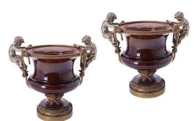 A pair of Continental gilt and silvered metal and pottery mounted jardinières