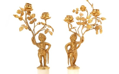 A pair of French late 18th century Louis XVI gilt bronze and marble candlesticks. H. 30 cm. (2)