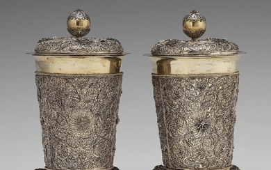 A pair of Swedish 17th century filigree and parcel-gilt silver beakers and covers, mark Rudolf Wittkopf, Stockholm 1698.