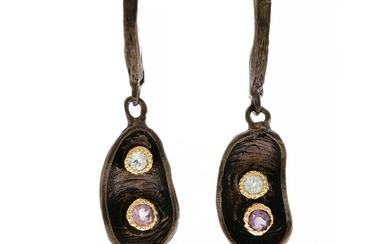 A pair of ear pendants each set with a circular-cut amethyst and topaz, mounted in black rhodium plated and partly gilded sterling silver. (2)