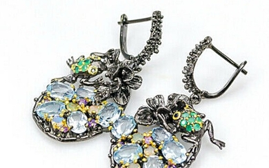 A pair of ear pendants each set with numerous topazes, sapphires, onyx, amethysts and opals, mounted in black rhodium and gold plated sterling silver. (2)