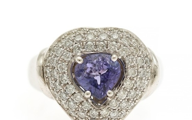 A tanzanite and diamond ring set with a tanzanite encircled by numerous diamonds, totalling app. 1.00 ct., mounted in 14k white gold. Size 57.