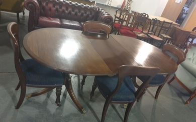 A twin pedestal mahogany Regency style table and four Regenc...