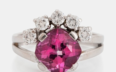 An 18K white gold ring set with a pink topaz and round brilliant-cut diamonds
