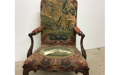 An early 19th century mahogany upholstered armchair on carve...