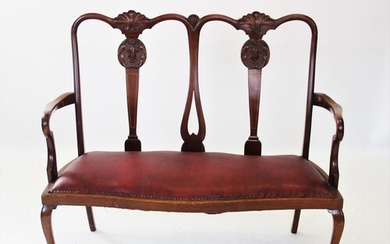 An early 20th century Chippendale revival twin seat mahogany...