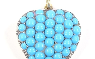 An unmarked gold blue stone pave-set heart pendant, height e...