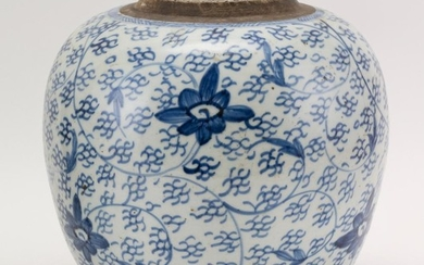 """CHINESE BLUE AND WHITE PORCELAIN GINGER JAR With lotus flower and vine decoration and a double foot ring. No cover. Height 10"""". Diam..."""