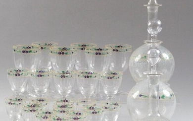 GLASS SERVICE PART, in faceted crystal with painted decoration of plums and leafy branches, comprising: six water glasses, five red wine glasses, eleven white wine glasses and three decanters (with attached stoppers). Water glass, H: 15 cm Red wine...