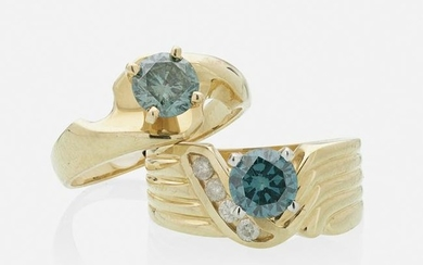 Irradiated blue diamond and yellow gold rings