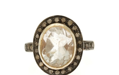 Jewels CPH: A topaz and diamond ring set with a oval-cut white topaz encircled by numerous sinlge-cut diamonds, mounted in sterling silver. Size 52.