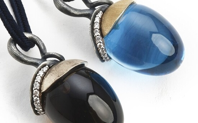 """Ole Lynggaard: Two necklaces with pendants """"Lotus"""" set with smokey quartz, topaz and diamonds, mounted in 18k gold and oxidized silver."""