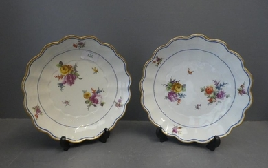 Pair of white floral dishes with a distinct mark to base 22...