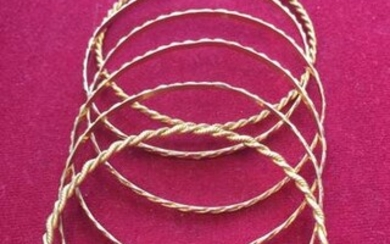 Six bracelets in 18k(750) yellow gold twisted in slight variations.