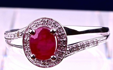 Superb designer ring (Dorian SELOSSE) in 18 kt white gold set with an oval Ruby certified by the IGITL laboratory of 0.46 carat and its ring body of diamonds set with grains for a total of 0.05 carat. Size 54 (can be modified). Gross weight: 2.10g.