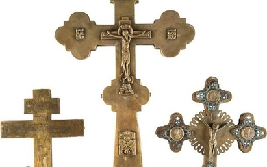 THREE BRASS CRUCIFIXES AND A MINIATURE ICON SHOWING THE
