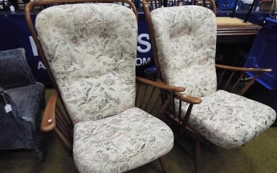 Two Ercol Evergreen wingback armchairs with original cushio...