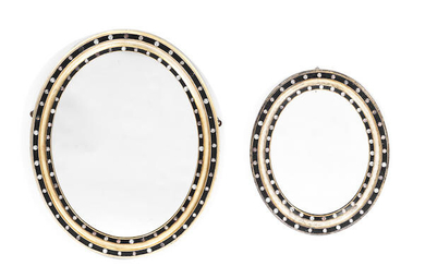 Two Irish 19th century oval silvered and ebonised mirrors