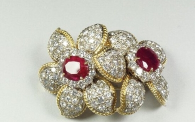Two-tone 18K (750/oo) gold transformation brooch featuring a...