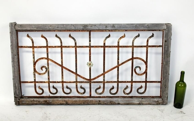 Wrought iron transom panel in wooden frame